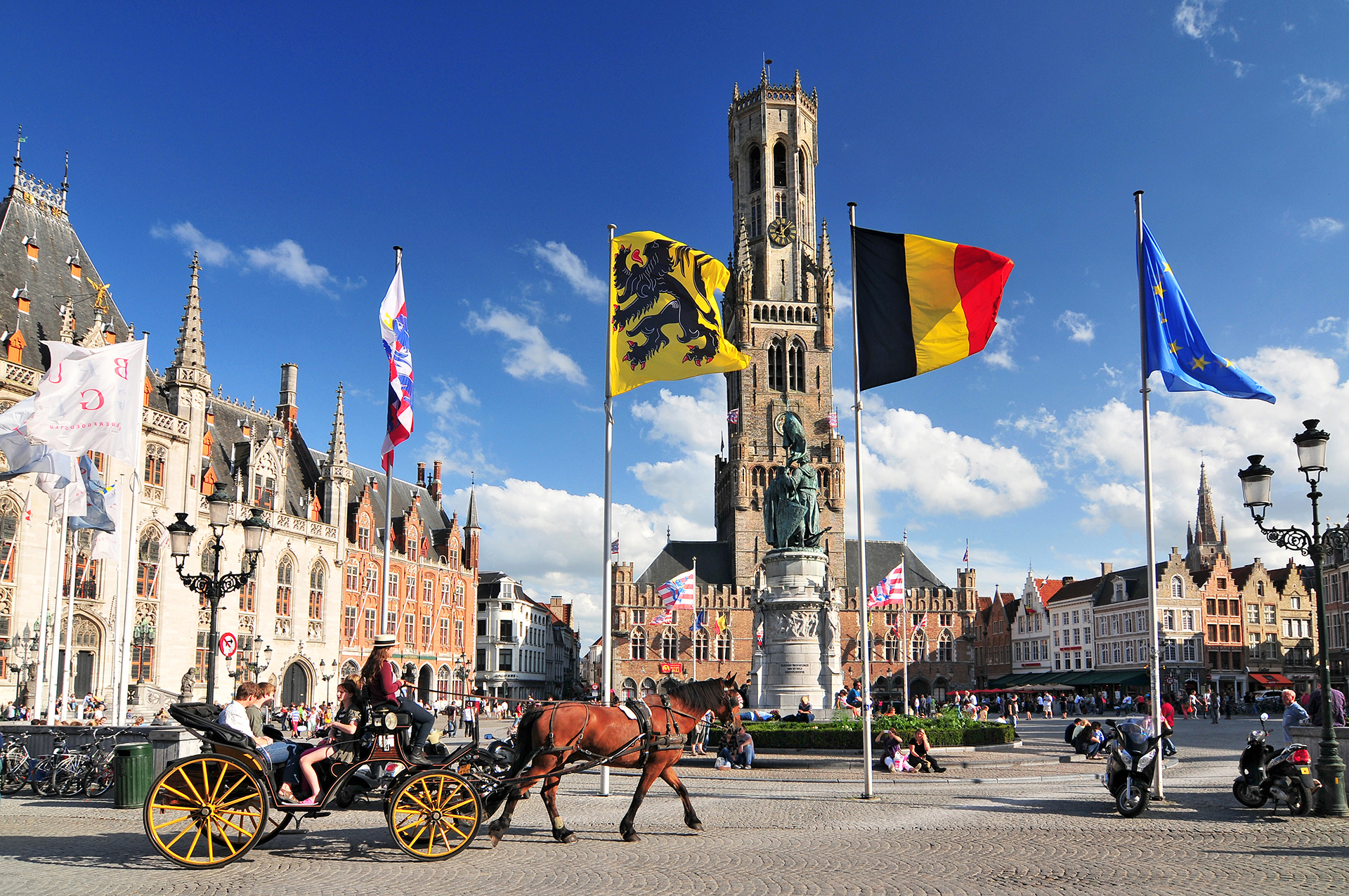 The historic belfry and city center square in the old medieval old town of Bruges (Brugge) Belgium.